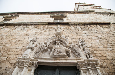 Detail above the doors on Sponza's palace in Dubrovnik