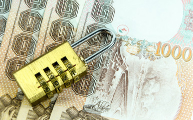 Padlock with thai banknote.