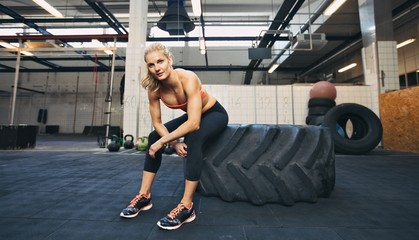 Crossfit woman taking break at gym