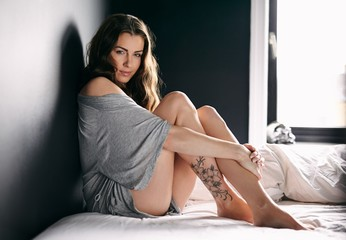 Attractive female model on bed