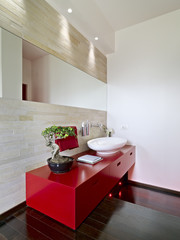 modern red furniture for washstand  in a bathroom