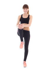 teenage girl in sports wear stretching leg isolated on white