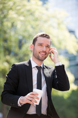 Businessman drinking a coffee during a break