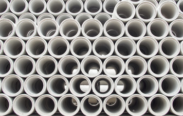 Stacked concrete pipes abstract