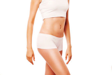Slim tanned woman's body. Isolated over white background.