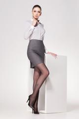 beautiful woman with long sexy legs dressed elegant posing