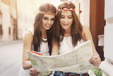 Boho girls looking for right way at map - Fine Art prints