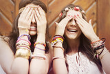 Boho girls covering eyes by hands poster