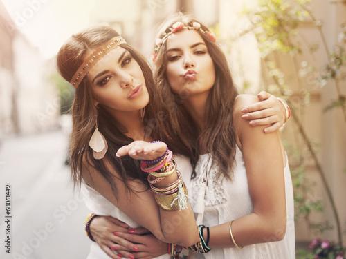 Beautiful boho girl blowing a kisses - 68061449