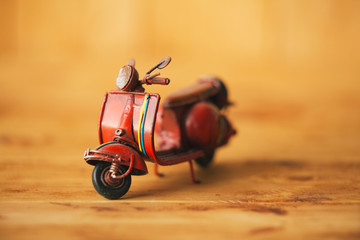 Close-up of miniature hand made toy motorcycle on rustic wood