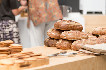 Freshly made bread on display in bakery on wooden table