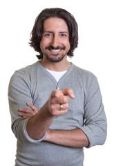 Turkish guy pointing at camera