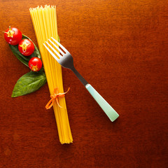 spaghetti with basil, cherry tomatoes and fork