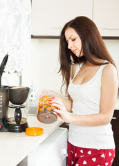 girl preparing  coffee in  kitchen