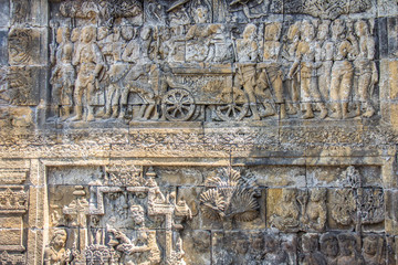 Ancient carvings in the wall of Borobudur Indonesia
