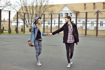 Full length of a smiling couple walking outdoor