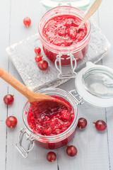 Jars gooseberry jam wooden table