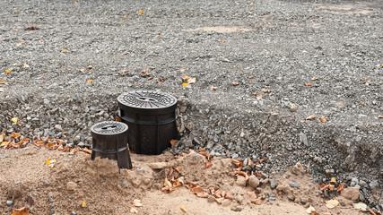 Eine neue Strassenkappe für Wasser und ein Unterflur-Hydrant