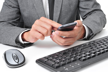 businessman using a smartphone in the office