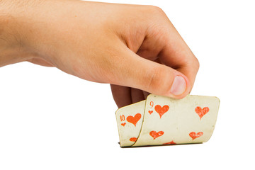 two playing cards in hand isolated on white background