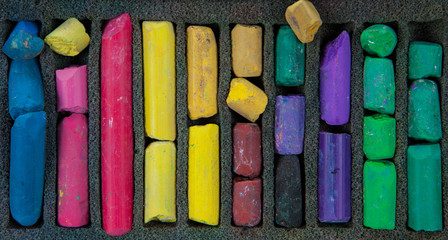set of multicolored pastel chalks on box