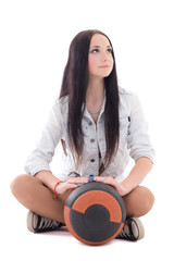 Cute teenager in denim sitting with ball
