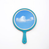hand mirror with reflection of blue sky, cloud isolate on white