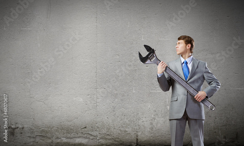 Businessman with wrench