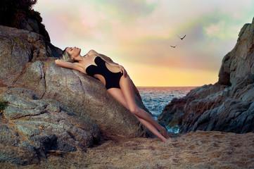Lady in black swimsuit on seashore