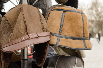 male brown decorated winter hats on rack