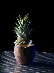 closeup of a pinacolada tropical coconut drink