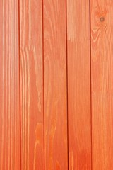 the textured wooden surface of red color
