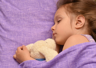 Little girl sleeping with toy