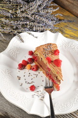Chocolate mousse cake with raspberries and lavender