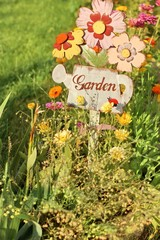 Garden sign, message on a wooden watering can