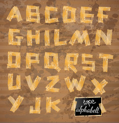 Vintage style alphabet made of yellow distressed tape