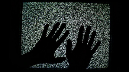 Male hands crawling up the TV screen