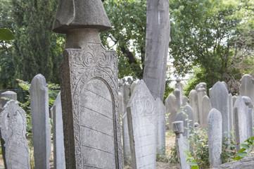 Ornate turkish headstones in graveyard