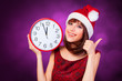 Brunette girl with huge clock and hat on violet background.