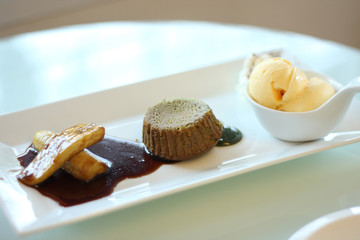 green tea lava cake served with ice cream and banana in syrup