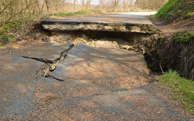 Destroyed asphalt road