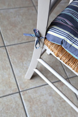 Cushion on a rustic chair in a kitchen