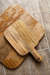 Wooden cutting board on a wooden floor