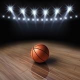 Ball on basketball court with spotlights , Arena