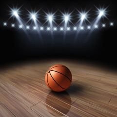 Ball on basketball court with spotlights , Arena