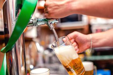 close-up of barman brewing a draft beer at pub