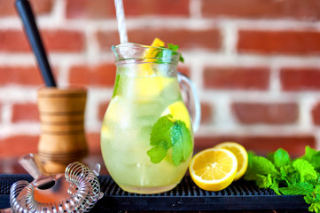 jug of fresh summer mind lemonade with ingredients