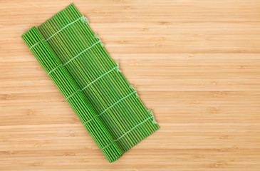 Japanese cooking mat over bamboo table