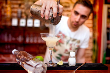 barman pouring a margarita cocktail served in casino and bar
