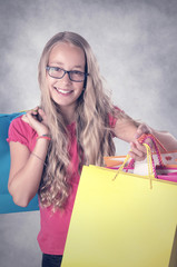 Blonde smiling Girl with Bags